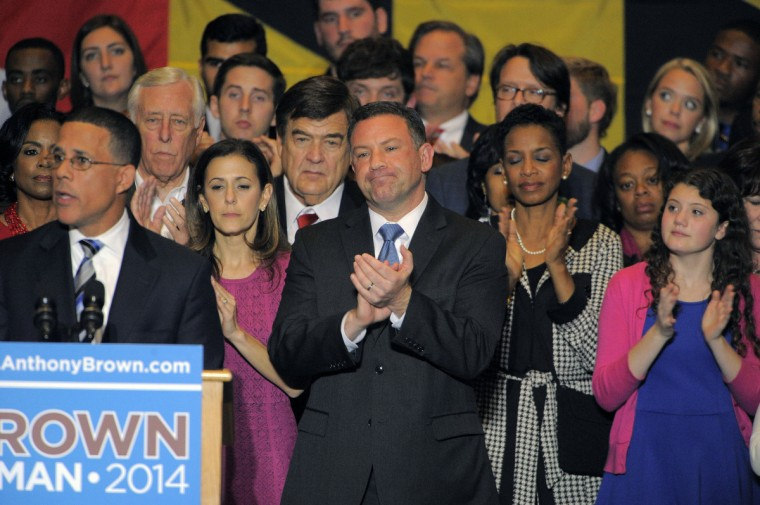 Running mate Ken Ulman stands behind gubernatorial candidate Anthony Brown (D-Md.) who concedes to Republican victor Larry Hogan at the Brown/Ulman election night party at the University of Maryland Wednesday. (Karl Merton Ferron / Baltimore Sun)