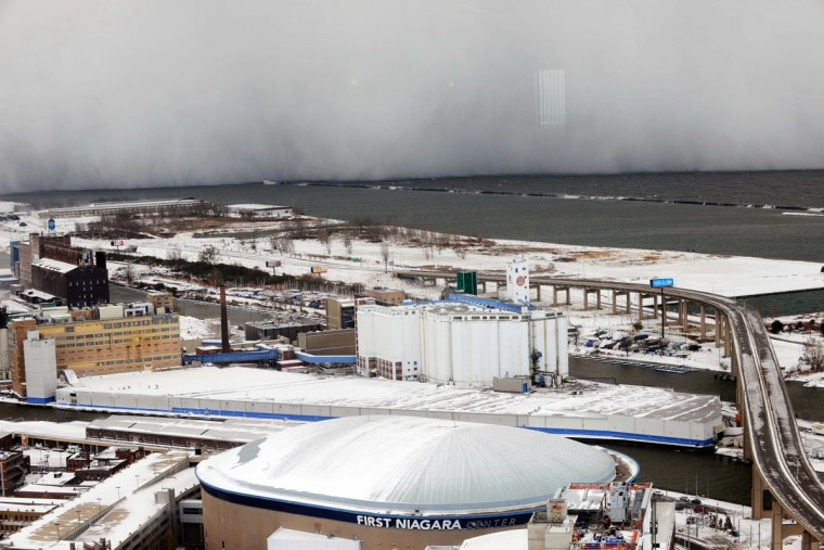 A lake-effect snow storm with freezing temperatures produces a wall of snow traveling over Lake Erie into Buffalo, N.Y. Nov. 18, 2014. Reuters/Gary Wiepert