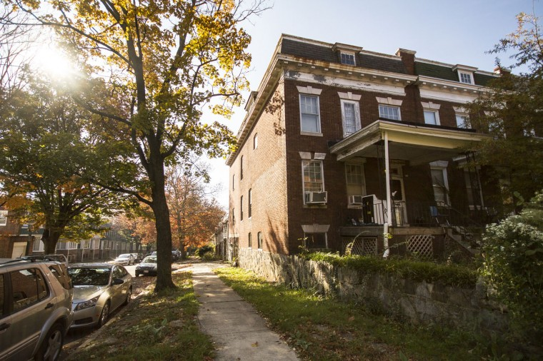 Homes throughout Waverly are an eclectic mix of porchfront homes, other rowhomes, and old vacation-style homes, many with yards. (Kalani Gordon/Baltimore Sun/Nov. 2014)