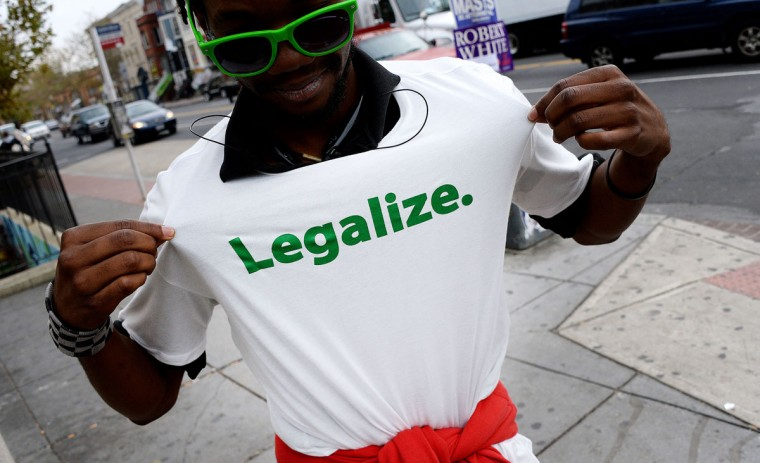 An activist from the D.C. Cannabis Campaign stands in the street during the midterm elections on Tuesday, Nov. 4, 2014, in Washington, D.C. Voters in the U.S. capital and two West Coast states will decide whether to legalize marijuana in a test for broader cannabis legalization efforts across the United States. (Olivier Douliery/Abaca Press/MCT)