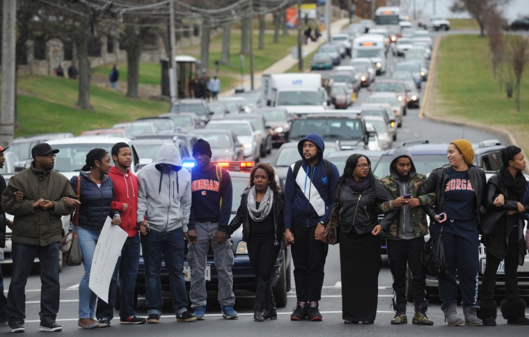 Morgan State students block the intersection of Perring Parkway and Cold Spring Lane during a rally in Baltimore on Tuesday, Nov. 25, 2014, in the wake of the grand jury decision not to indict officer Darren Wilson in the shooting death of Ferguson, Mo., teen Michael Brown. (Jerry Jackson/Baltimore Sun)