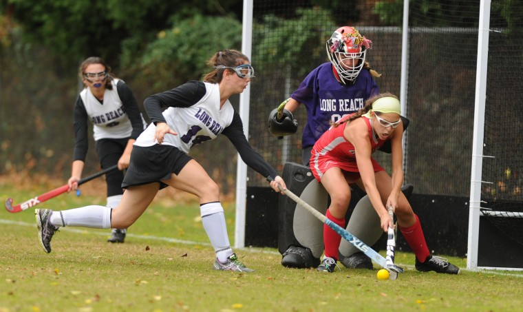 Long Reach's Grace LaMoure, looks to take ball possession away from Glenelg's Mia Astrar on a play in front of Long Reach goalie Alina Milauskas during the 3A east reagional field hockey championship game at Long Reach High School on Wednesday, October 29. (Brian Krista/BSMG)