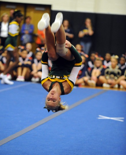 Wilde Lake sophomore Lindsay Murray performs a series of flip during her squad's performance at the Fall 2014 Howard County Varsity Cheerleading Competition at Oakland Mills High School on Thursday, October 30. (Brian Krista/BSMG)