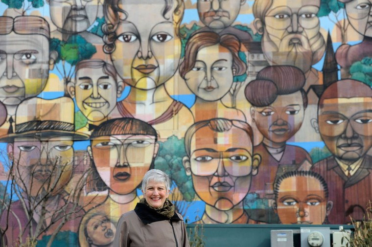 3/11/13: Karen Stokes, executive director of Greater Homewood Community Corporation, stands near a mural outside the Waverly Giant grocery store Monday, March 11, 2013. (Photo by Steve Ruark)