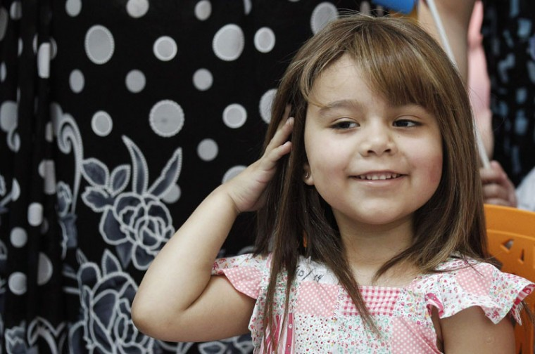 Alexandra Munoz, 5, who lost her hair due to chemotherapy for a brain tumor, plays with her new natural hair wig after it was fitted to her for the first time in the cancer ward of the Luis Calvo Mackenna Hospital in Santiago, October 23, 2014. The wigs, handmade by Italian-Chilean hair stylist Marcelo Avatte and his team, have helped the children regain their self-esteem and confidence during cancer treatment. Renowned for making customized wigs, Avatte has donated more than 300 wigs since 2009 and says he was motivated to begin the project by the pain he felt when his own son lost his hair during chemotherapy. (Rodrigo Garrido/Reuters)