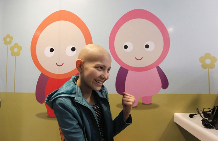 Isidora Serrano, 14, who lost her hair due to chemotherapy to treat her bone cancer, reacts upon hearing from her doctor the positive results of a blood test during her daily treatment in the cancer ward of the Luis Calvo Mackenna Hospital in Santiago, October 20, 2014. The wigs, handmade by Italian-Chilean hair stylist Marcelo Avatte and his team, have helped the children regain their self-esteem and confidence during cancer treatment. Renowned for making customized wigs, Avatte has donated more than 300 wigs since 2009 and says he was motivated to begin the project by the pain he felt when his own son lost his hair during chemotherapy. (Rodrigo Garrido/Reuters)
