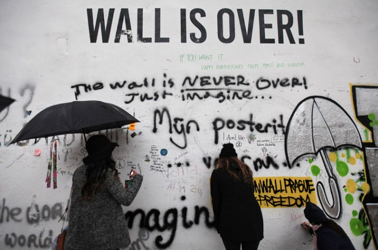 People write messages on the legendary John Lennon Wall in the historical centre of Prague November 18, 2014. Prague's graffiti-covered John Lennon Wall, a favorite photo spot for tourists and a symbol of Western culture under the former Communist regime, was painted completely white on Tuesday. (David W Cerny/Reuters)