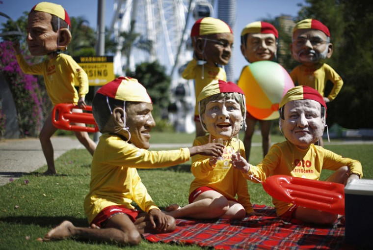 Protesters, wearing masks depicting G20 leaders, and dressed as Australian surf lifesavers call for global equality among nations outside the venue site of the annual G20 leaders summit in Brisbane, November 14, 2014. Leaders of the top 20 industrialized nations will gather in Brisbane November 15-16 for their annual G20 summit. The leaders depicted are (front row, L-R), U.S. President Barack Obama, Germany's Chancellor Angela Merkel, British Prime Minister David Cameron, (back row, L-R), Australian Prime Minister Tony Abbott, South African President Jacob Zuma, China's President Xi Jinping and Indian Prime Minister Narendra Modi. (Jason Reed/Reuters)