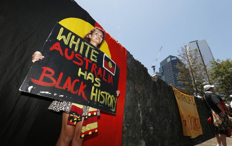 Paprika Summers holds a banner as she protests for human rights for Australia's Aboriginal community near the venue of the annual G20 leaders summit in Brisbane, November 14, 2014. Leaders of the top 20 industrialized nations will gather in Brisbane November 15-16 for their annual G20 summit. (Jason Reed/Reuters)