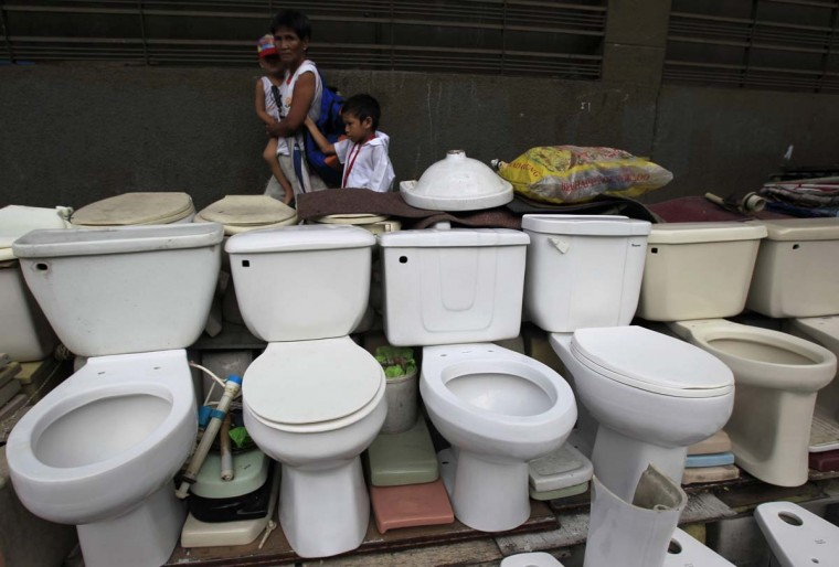 A woman walks past a row of recycled toilet bowls for sale at 1,500 pesos ($34) each along a major street in Manila November 19, 2014. The United Nations General Assembly has declared November 19 as World Toilet Day to raise awareness about the need for all human beings to have access to sanitation. (Romeo Ranoco/Reuters)