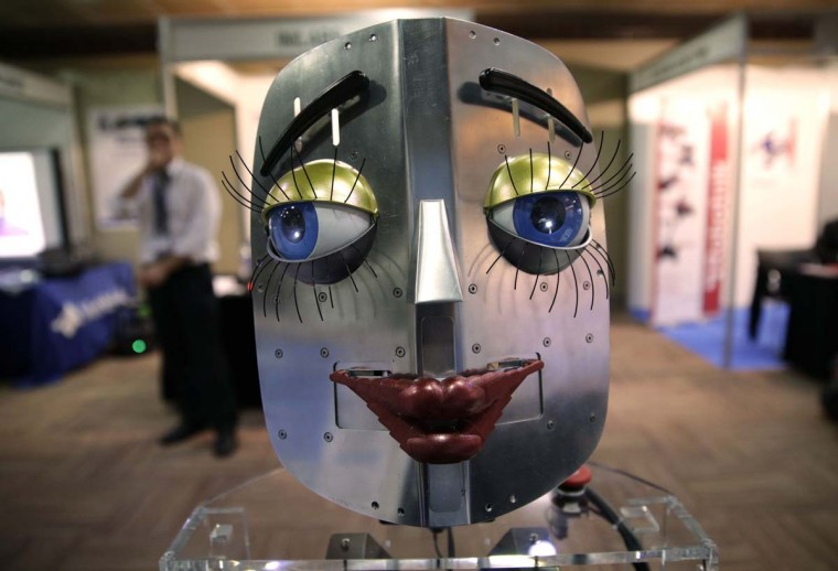 A humanoid robot face is displayed at a stand during the International Conference on Humanoid Robots in Madrid November 19, 2014. (Andrea Comas/Reuters)