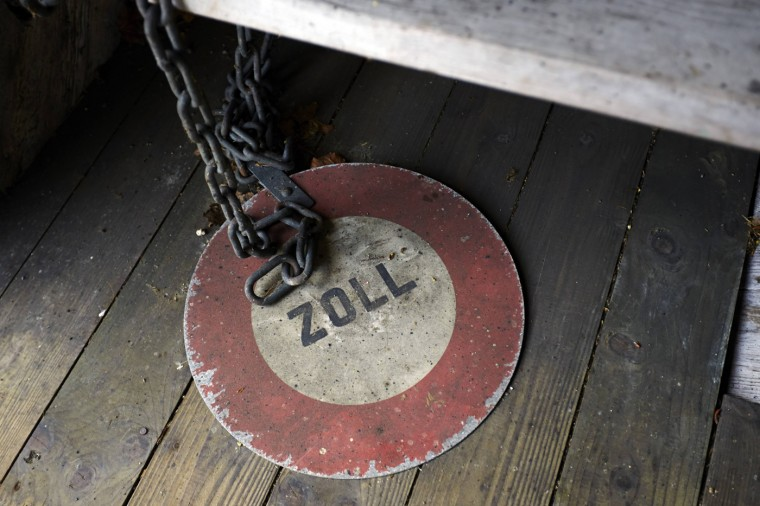 A Zoll (Customs) sign is seen on a wooden bridge over the Rhein river between Switzerland and Germany in Rheinau May 1, 2014.