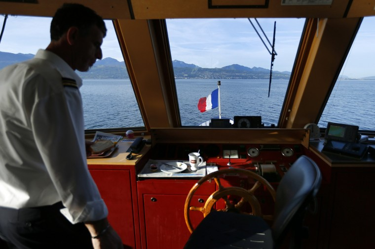 Luta Menduh, captain with the Lake Geneva General Navigation Company (CGN), steers his ship on Lake Leman on the border between Switzerland and France near Lausanne May 8, 2014.