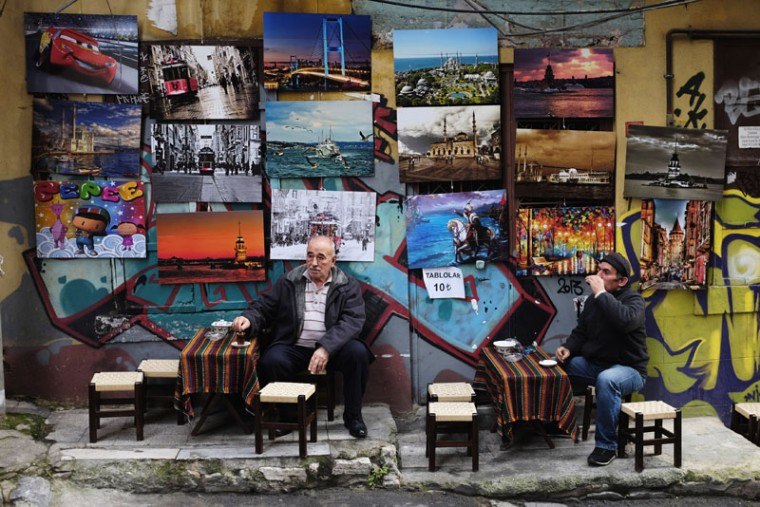 Turkish men drink tea outside of a coffee shop in Istanbul November 18, 2014. (Murad Sezer/Reuters)