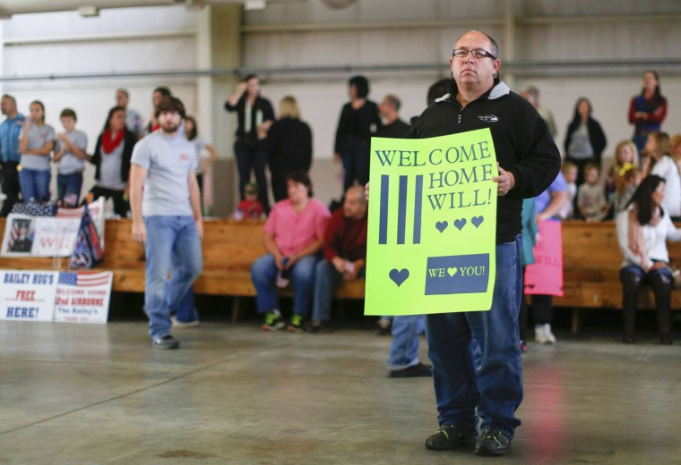 Roy Leeds holds a sign as he waits for his nephew who is a paratrooper with the 1st Brigade Combat Team, 82nd Airborne Division, before returning home from Afghanistan, at Pope Army Airfield in Fort Bragg, North Carolina November 5, 2014. Approximately 300 troops arrived home after being deployed since February 2014, according to the military. (Chris Keane/Reuters)