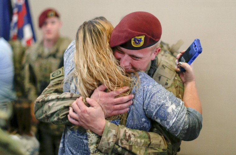 Zachary Smith, a paratrooper with the 1st Brigade Combat Team, 82nd Airborne Division, hugs his mom Angie Gibson after returning home from Afghanistan at Pope Army Airfield in Fort Bragg, North Carolina November 5, 2014. Approximately 300 troops arrived home after being deployed since February 2014, according to the military. (Chris Keane/Reuters)