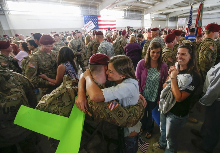 John Jacoby, a paratrooper with the 1st Brigade Combat Team, 82nd Airborne Division, hugs his girlfriend Emiliee Chance after returning home from Afghanistan at Pope Army Airfield in Fort Bragg, North Carolina November 5, 2014. Approximately 300 troops arrived home after being deployed since February 2014, according to the military. (Chris Keane/Reuters)