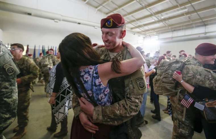 A paratrooper with the 1st Brigade Combat Team, 82nd Airborne Division, hugs his wife after returning home from Afghanistan at Pope Army Airfield in Fort Bragg, North Carolina November 5, 2014. Approximately 300 troops arrived home after being deployed since February 2014, according to the military. (Chris Keane/Reuters)