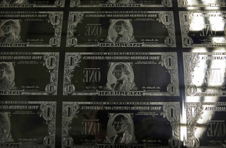 An engraving plate for United States one dollar bills is seen during production at the Bureau of Engraving and Printing in Washington November 14, 2014. The plate goes on the printing press which prints the currency. (Gary Cameron/Reuters)