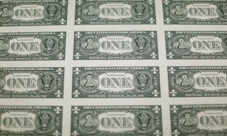 A sheet of the backside of United States one dollar bills is seen during production at the Bureau of Engraving and Printing in Washington November 14, 2014. (Gary Cameron/Reuters)