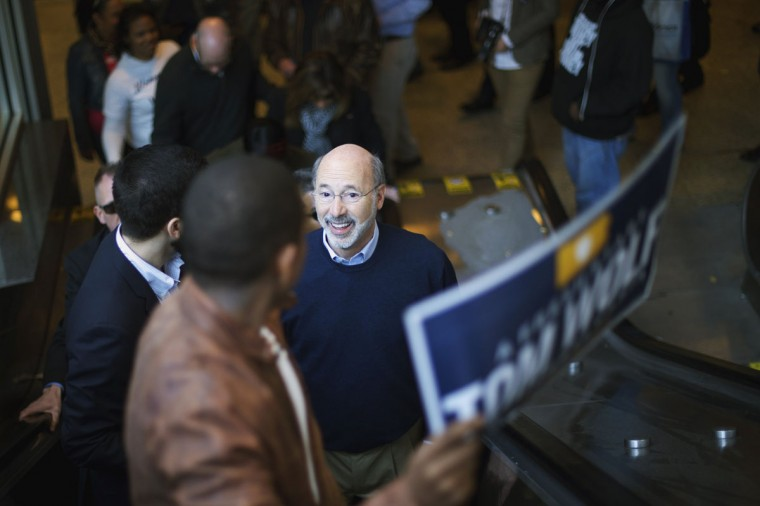 Democrat challenger for Pennsylvania Governor Tom Wolf ascends to street level on an escalator after greeting commuters on election day morning in Philadelphia, Pennsylvania, November 4, 2014. (Mark Makela/Reuters)