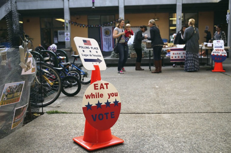 Voters gather at a bake sale at a polling place on Election Day in San Francisco, California November 4, 2014. Voters in the United States took to the polls on Tuesday, casting ballots in midterm elections. (Robert Galbraith/Reuters)