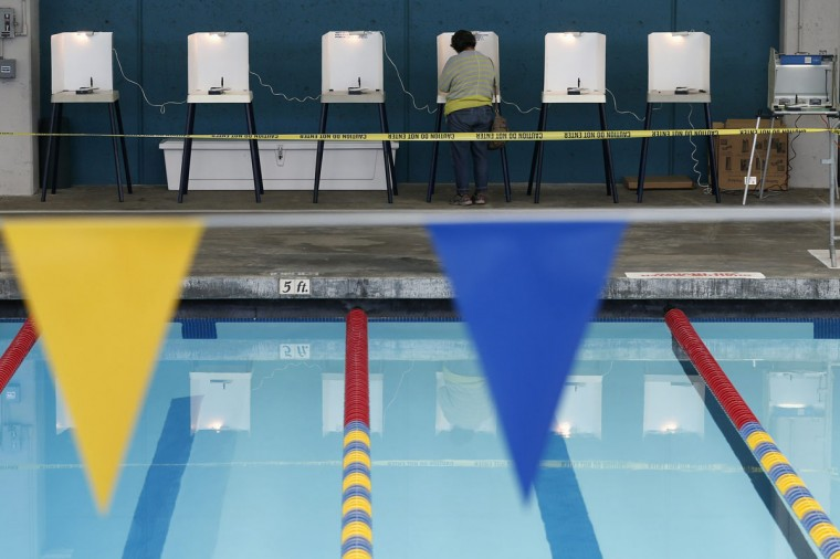 A woman fills out her ballot at a polling place at a swimming pool on Election Day in Los Angeles, California November 4, 2014. Voters in the United States took to the polls on Tuesday, casting ballots in midterm elections. (Lucy Nicholson/Reuters)