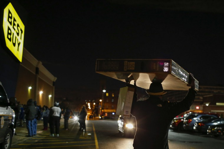 A shopper carries a TV outside a Best Buy store in Newport, New Jersey November 27, 2014. Best Buy opened on Thanksgiving evening at 5 pm, ahead of many other Black Friday retailers. (Eduardo Munoz/Reuters)