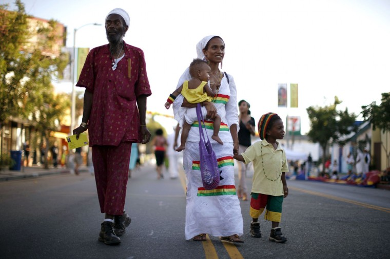 Najara Apraku, 28, (2nd L) holds her 11-month-old son Selassi Ra Shabaka as she walks with her husband Jamaiel Shabaka and son Kwame Negast Shabaka in the Little Ethiopia area of Los Angeles, California September 14, 2014.