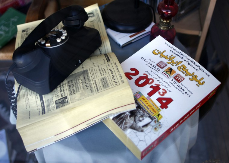 "An Iranian American phone directory is seen in a store window in the Westwood district of Los Angeles, near ""Persian Square,"" in California August 12, 2014. The area is nicknamed ""Tehrangeles"" and is home to many migrants from Iran."