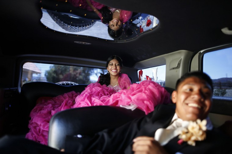 Mimi Pineda, 15, (L) whose parents are from El Salvador, rides to church in a limousine with her friend Christian Flores, 17, during her quinceanera in Santa Clarita, California August 23, 2014.