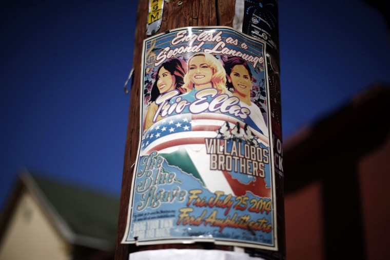 "A flyer for a concert named ""English as a Second Language"", of Latino artists singing in Spanish and English, is seen in the Boyle Heights area of Los Angeles, home to many Mexican migrants, in California August 5, 2014."