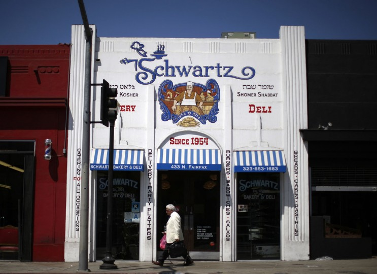 A man walks past the kosher Schwartz Bakery in the Fairfax district of Los Angeles, California August 14, 2014. Los Angeles is a culturally thriving city and one of the most ethnically diverse in the United States, with a population that is 48.5 percent Latino and 11.3 percent Asian, according to a 2010 census.