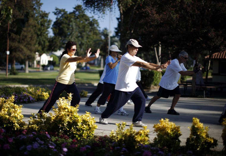 Johney Yu (2nd R), 75, who emigrated from China 40 years ago, and Diana Yang (L), who emigrated from China 28 years ago, practice tai chi at a daily class in Alhambra, home of many Chinese and Vietnamese migrants, in California August 14, 2014.