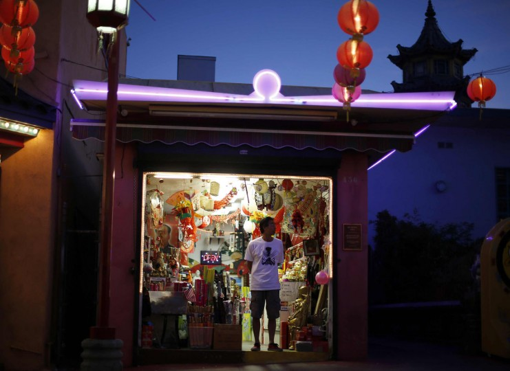 A man stands in a store selling lanterns in Chinatown in Los Angeles, California August 13, 2014.