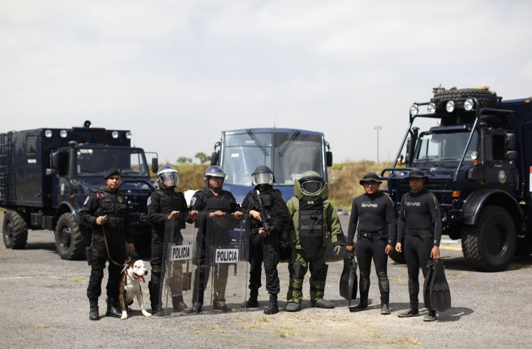 """Members of the Task Force for Mexico City at their base in Mexico City. In Mexico, """"when violent action by a crowd cannot be deterred, a scale of force will be applied progressively consisting of 1. verbal persuasion or deterrence 2. reduced physical movements 3. use of non-lethal incapacitating weapons, and 4. use of firearms or lethal force"""". (Claudia Daut/Reuters)"""