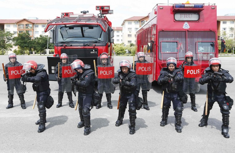 Malaysia's public order police, the Federal Reserve Unit (FRU), wearing riot control equipment at their headquarters in Kuala Lumpur November 20, 2014In Malaysia, the FRU are only permitted to use firearms in cases where the protesters are using firearms. Firearms have not been used in the 59 years since the FRU was formed. Picture taken November 20. (Olivia Harris/Reuters)