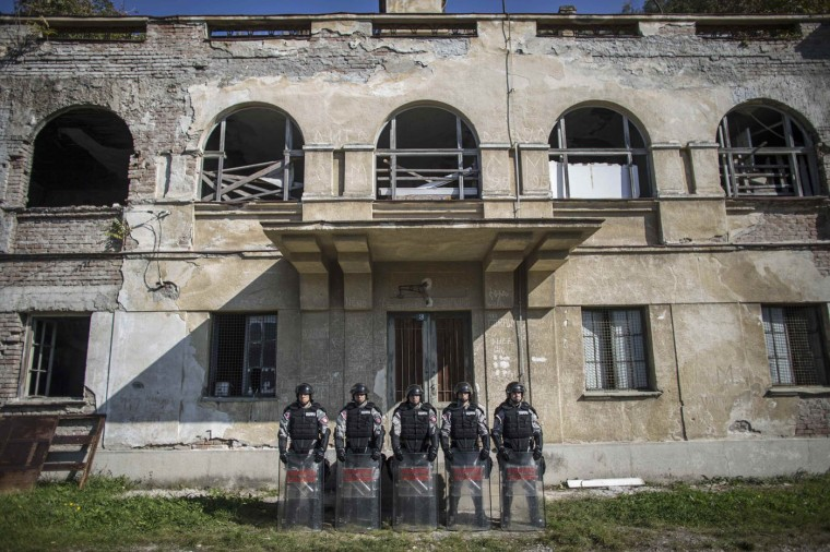 Serbian gendarmerie officers pose for a picture inside their base in Belgrade October 9, 2014. When the killing of an unarmed black teenager by a white policeman in Ferguson, Missouri, last August sparked sometimes violent protests, the response of police in camouflage gear and armoured vehicles wielding stun grenades and assault rifles seemed more like a combat operation than a public order measure. Some U.S. police departments have recently acquired U.S. military-surplus hardware from wars abroad, but there are many law enforcers around the world whose rules of engagement also allow the use of lethal force with relatively few restrictions. But for every regulation that gives police wide scope to use firearms, there is another code that sharply limits their use. In Serbia, police may use measures ranging from batons to special vehicles, water cannon and tear gas on groups of people who have gathered illegally and are behaving in a way that is violent or could cause violence, but they may use firearms only when life is endangered. Picture taken October 9. (Marko Djurica/Reuters)
