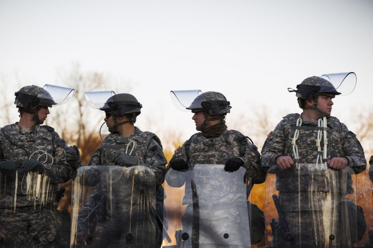 National Guard soldiers stand in formation outside the Ferguson Police Department following a night of rioting in Ferguson, Missouri November 25, 2014. Aiming to head off new looting and rioting, Missouri's governor on Tuesday ordered National Guard reinforcements into the St. Louis suburb of Ferguson following overnight violence ignited by the clearing of a white police officer in the fatal shooting of an unarmed black teenager. (Lucas Jackson/Reuters)