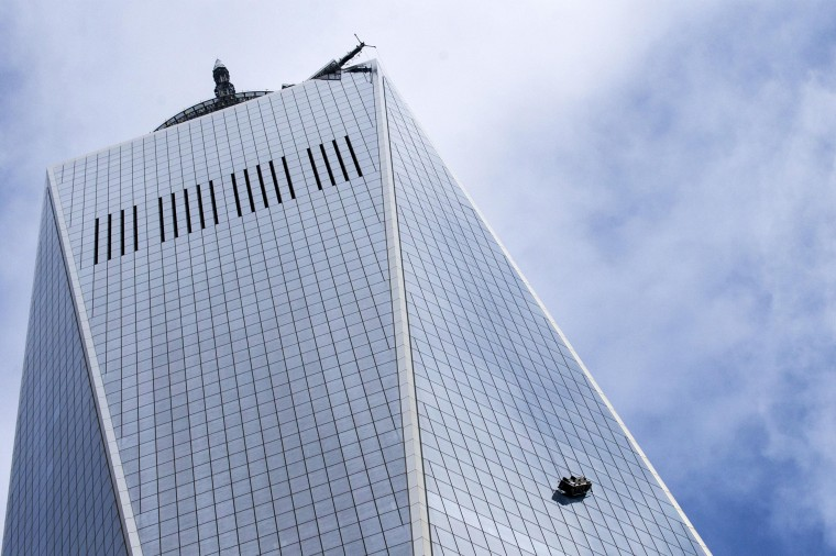 Stranded window washers hang on the side of One World Trade Center November 12, 2014. New York City fire fighters were trying to rescue at least one window washer on Wednesday thought to be trapped on broken scaffolding that was dangling outside the 69th floor of One World Trade Center, local officials said. (Brendan McDermid/Reuters)
