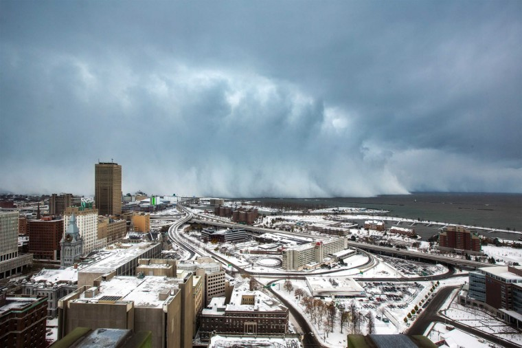 Storm clouds and snow blows off Lake Erie in Buffalo, New York, November 18, 2014. An autumn blizzard dumped a year's worth of snow in three days on Western New York state, where five people died and residents, some stranded overnight in cars, braced for another pummeling expected later on Wednesday. (Lindsay DeDario/Reuters)