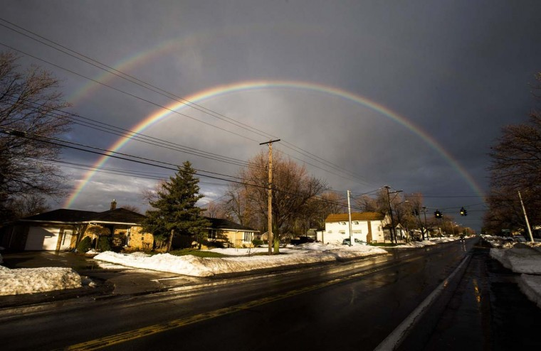 A rainbow forms over a neighbourhood following a massive snow storm in West Seneca, New York November 24, 2014. Emergency workers filled thousands of sandbags on Sunday as the area around Buffalo, New York braced for potential flooding as warming temperatures began to melt up to seven feet (2 metres) of snow. (Mark Blinch/Reuters)