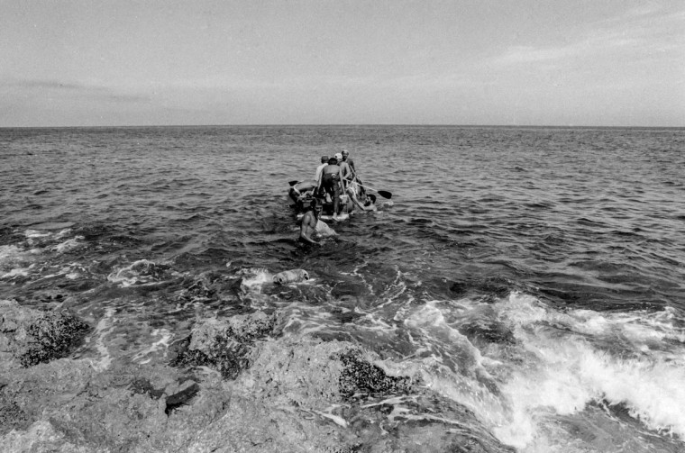 Would-be emigrants launch a makeshift boat into the Straits of Florida towards the U.S., on the last day of the 1994 Cuban Exodus in Havana on September 13, 1994. (REUTERS/Rolando Pujol Rodriguez)