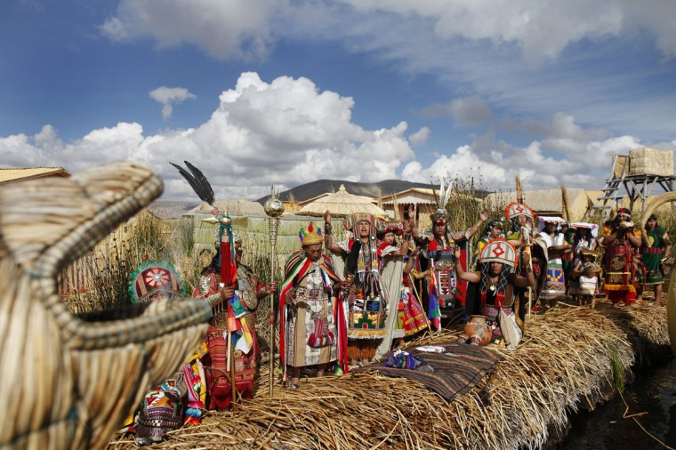 Andean actors perform during a re-enactment of the legend of Manco Capac and Mama Ocllo in a Uros island at Lake Titicaca in Puno on November 5, 2014. According to an Inca legend, Manco Capac and Mama Occllo emerged from the waters of the lake carrying a golden staff instructed by the sun god Inti to create a temple in the spot where the staff sank into the earth. (REUTERS/Enrique Castro-Mendivil)