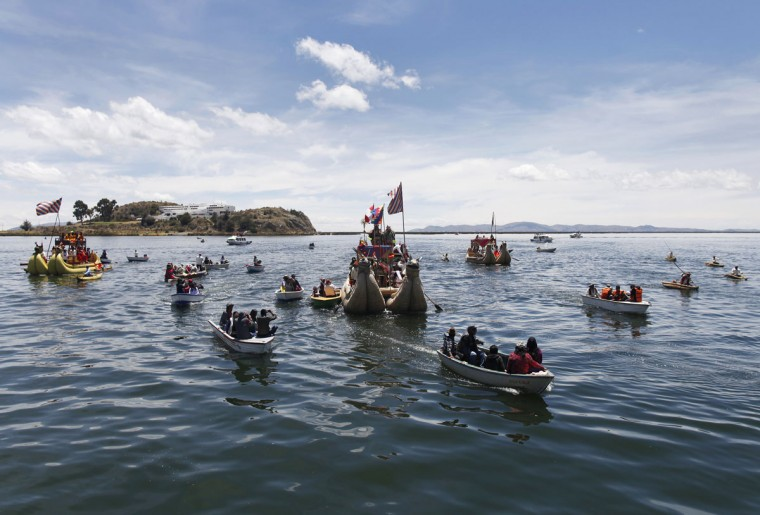 Andean actors sail in a totora raft during a re-enactment of the legend of Manco Capac and Mama Ocllo in a Uros island at Lake Titicaca in Puno on November 5, 2014. (REUTERS/Enrique Castro-Mendivil)
