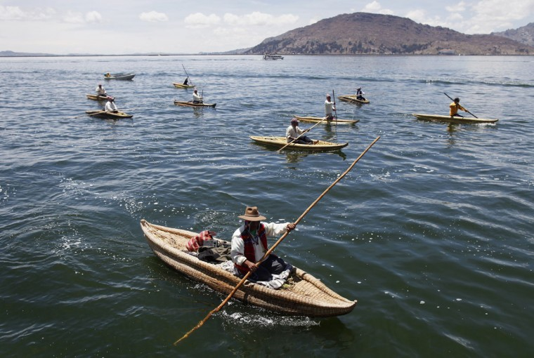 Andeans row their totora boats as they accompany actors during a re-enactment of the legend of Manco Capac and Mama Ocllo in a Uros island at Lake Titicaca in Puno on November 5, 2014. (REUTERS/Enrique Castro-Mendivil)