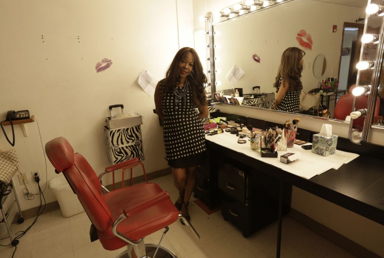 Former Cuban rafter Moraima Alfonso, 51, poses in the America TV dressing room where she works as a makeup artist in Miami, September 17, 2014. Alfonso said she spent 10 days at sea and was suffering hallucinations when she was picked up by the U.S. Coast Guard in 1994. (REUTERS/Enrique de la Osa)