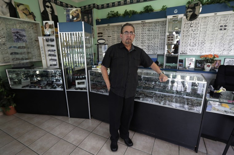 Former Cuban rafter Jose Ramon Velazquez, 60, poses in one of his optical stores in Miami, September 22, 2014. Velazquez said he was a radiologist when he decided to climb into a makeshift boat with 22 other migrants in 1994. (REUTERS/Enrique de la Osa)