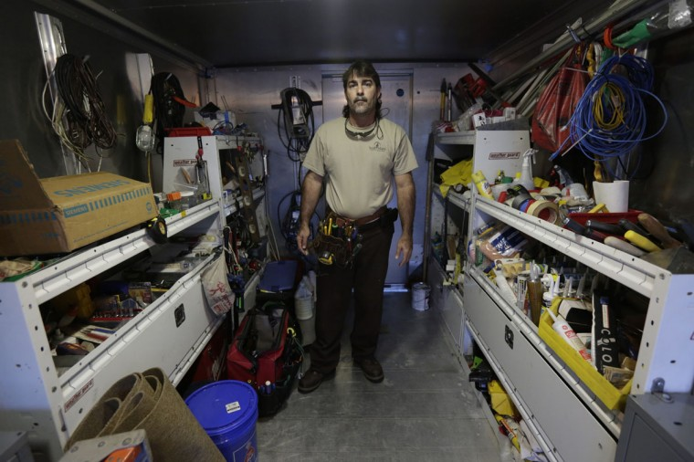 Former Cuban rafter Carlos Hernandez, 45, poses in his workshop in Miami September 18, 2014. Hernandez said he was a youth baseball star in Cuba when he decided to climb into a catamaran in 1994 and head for the U.S. (REUTERS/Enrique de la Osa)