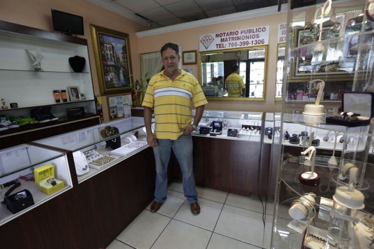 Former Cuban rafter Faustino Jose, 60, poses in his jewelry store in Miami on September 16, 2014. Faustino, who was an industrial engineer in Cuba, said he studied all of Thor Heyerdahl's books about rafting before building his own and leaving Cuba in 1994. (REUTERS/Enrique de la Osa)